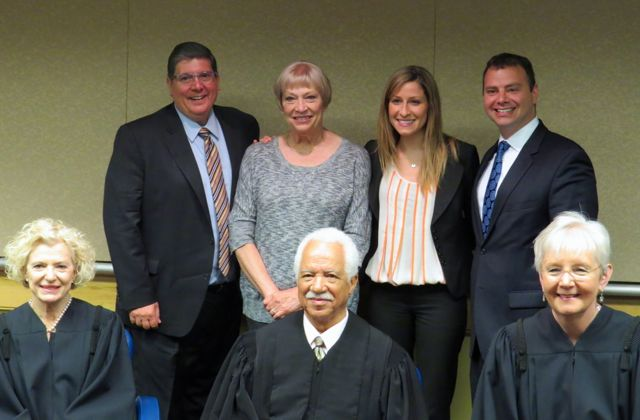 ISBA 2nd Vice President Richard D. Felice (rear, left) is shown with new admittee Stephanie Sainsbury (rear, second from left), her mother and Justinian Society President Gregg Garofalo. Seated at front are Illinois Suprme Court Justices Anne Burke, Charles Freeman and Mary Jane Theis.