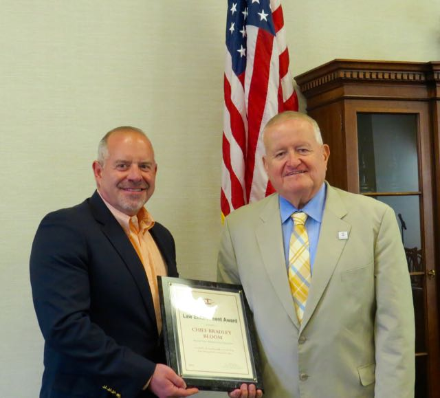 ISBA President-elect Hon. Russell W. Hartigan (right) presents a 2016 ISBA Law Enforcement Award to retired Hinsdale Police Chief Bradley Bloom on July 22 at the Village Hall of Hinsdale.