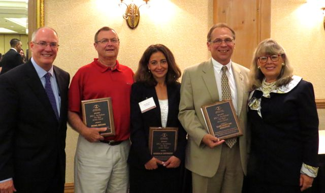 ISBA Past President John E. Thies (left) and ISBA President Paula H. Holderman (right) present McAndrews Awards to (from left) Michael McElvain, McDonald's Corp. and the Clark County Bar Association.