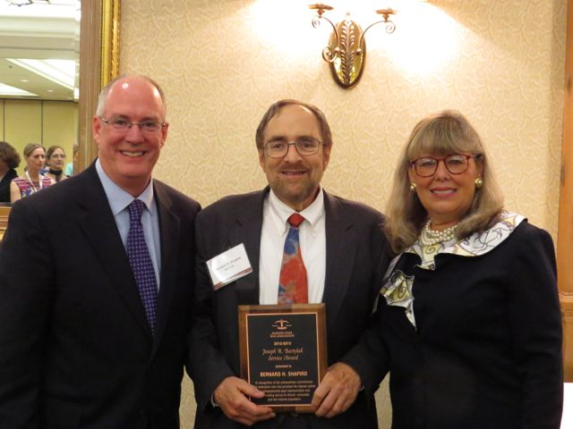 Bernie Shapiro (center) receives the 2013 Bartylak Award from outgoing ISBA President John E. Thies and incoming ISBA President Paula H. Holderman.