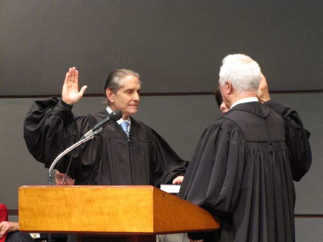 John B. Simon is sworn-in by Illinois Supreme Court Justice Charles E. Freeman.