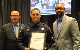 Illinois State Bar Association President Vincent F. Cornelius (far right) and 2nd Vice President James F. McCluskey (far left) presented an ISBA Law Enforcement Award to Naperville Police Officer Shaun Ferguson on Sept. 20 at Naperville City Hall.