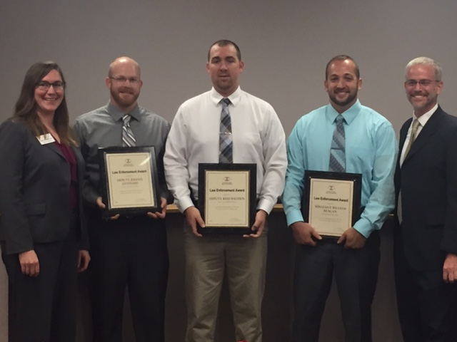 Illinois State Bar Association Board Treasurer Angelica W. Wawrzynek (far left) and Perry County Assistant State's Attorney David Searby (far right) presented an ISBA Law Enforcement Award to Perry County Sheriff Deputies Jeremy Gothard, Reid Bastien, and Sergeant William Reagan on Sept. 26 at Pinckneyville City Hall.