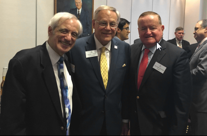Ellis Levin, Third Vice President Dennis Orsey, and President Russell Hartigan