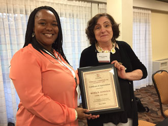 Latasha Barnes giving Roza Gossage her plaque for her work as chair of Disability Law.