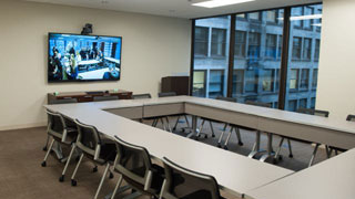 Conference Room D boardroom style with video conferencing