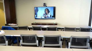 Conference Room E classroom style with video conferencing