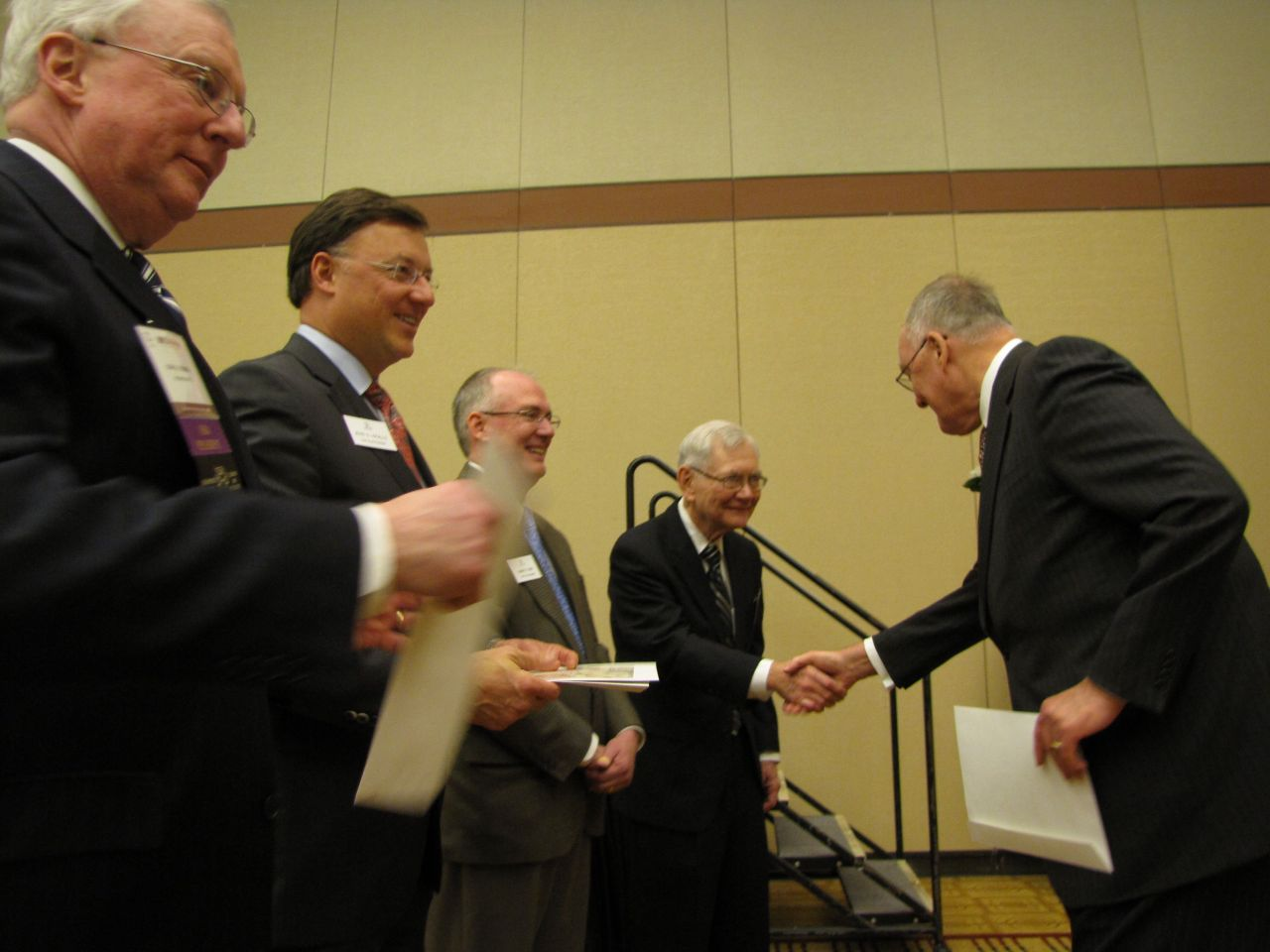 Former Gov. Jim Thompson receives his certificate as a member of the 1959 Class of Senior Counsellors.
