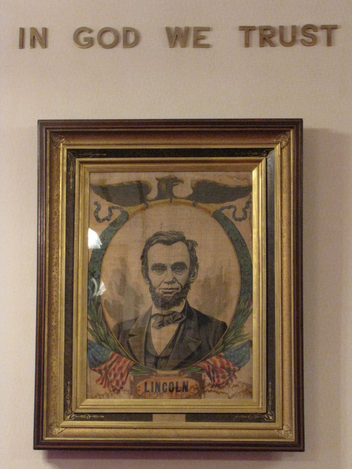 An image of Abraham Lincoln sits on the wall opposite ...