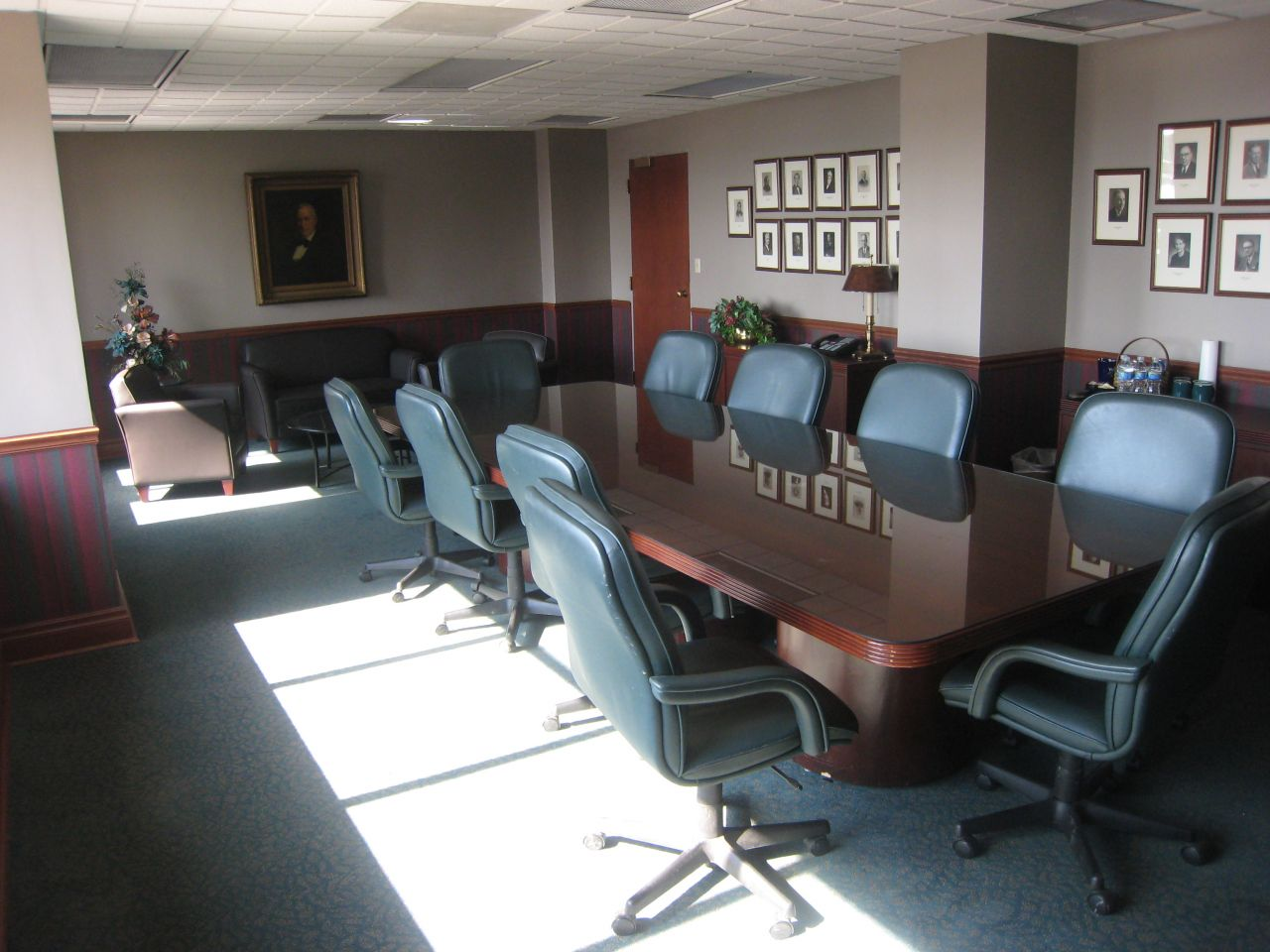 Main conference room with firm leaders (including Abraham Lincoln) pictured on wall