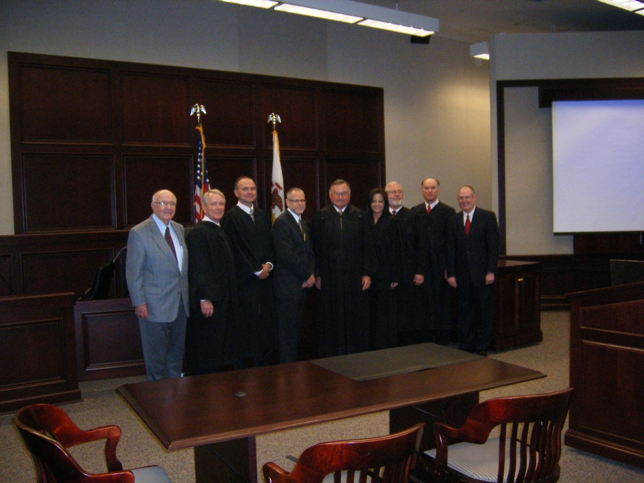 Justice Karmeier and other Judges from 5th District with ISBA 3rd Vice President, John E. Thies (far right) and his dad, ISBA Past President Richard L. Thies (far left).