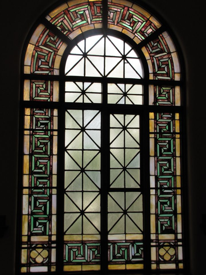 Stained-glass window behind judge's bench