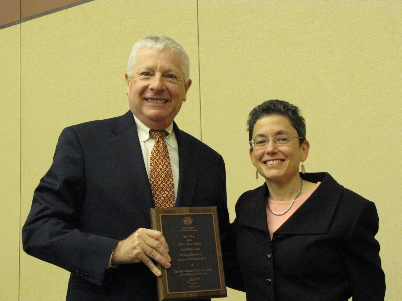 IBF past president David Sosin presents the Distinguished Service to Law & Society Award to Judge Nancy J. Katz