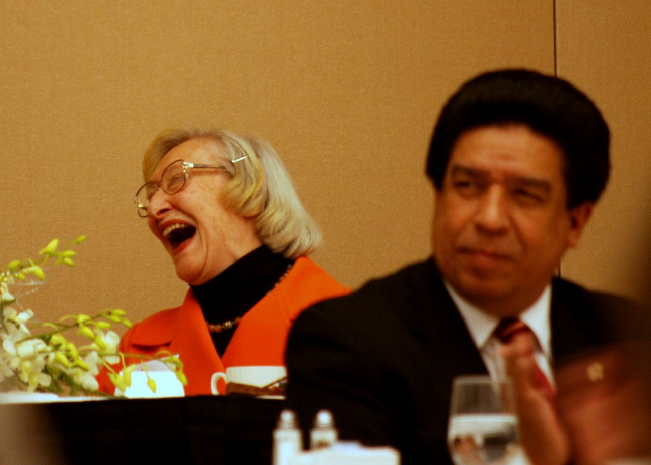 Dawn Clark Netsch enjoys a laugh as Cook County Judge Jesse Reyes looks on.