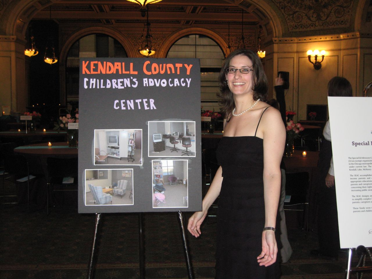 Summer Soiree co-chair Debra Liss with Kendall County charity chart