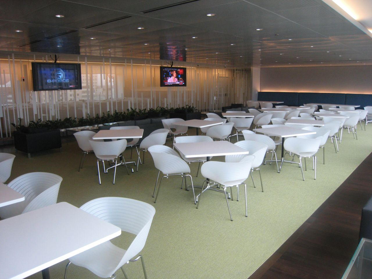 The 24th-floor employee cafeteria features two large-flat screen TVs and river views.