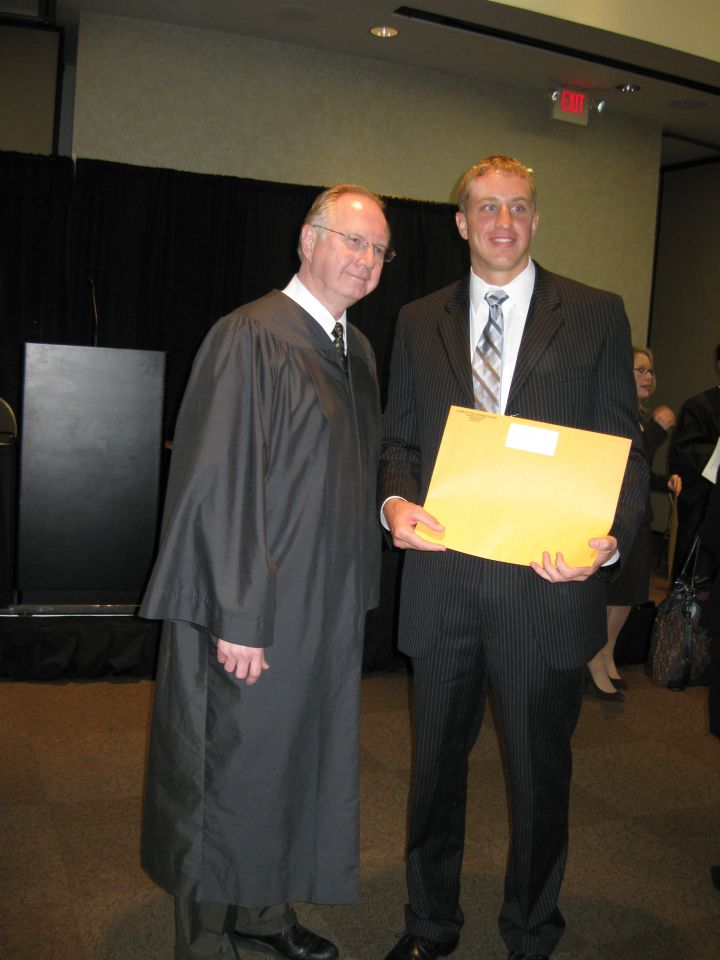 Justice Thomas L. Kilbride and new admittee Matthew Petersen