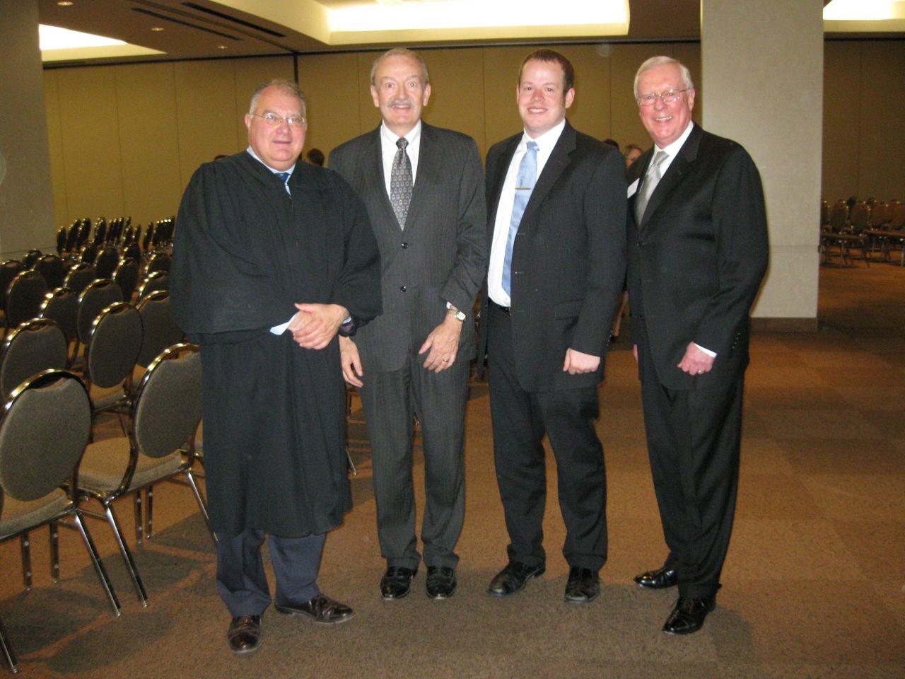 Justice Robert L. Carter, ISBA member Mark McGrath, his son, new admittee Patrick McGrath and ISBA President John O'Brien