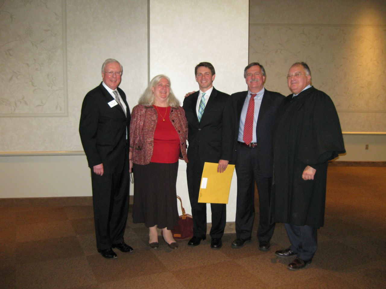 ISBA President John O'Brien, Deb Baron, her son, new admittee David Baron, his father, ISBA member Dennis Baron and Justice Robert L. Carter