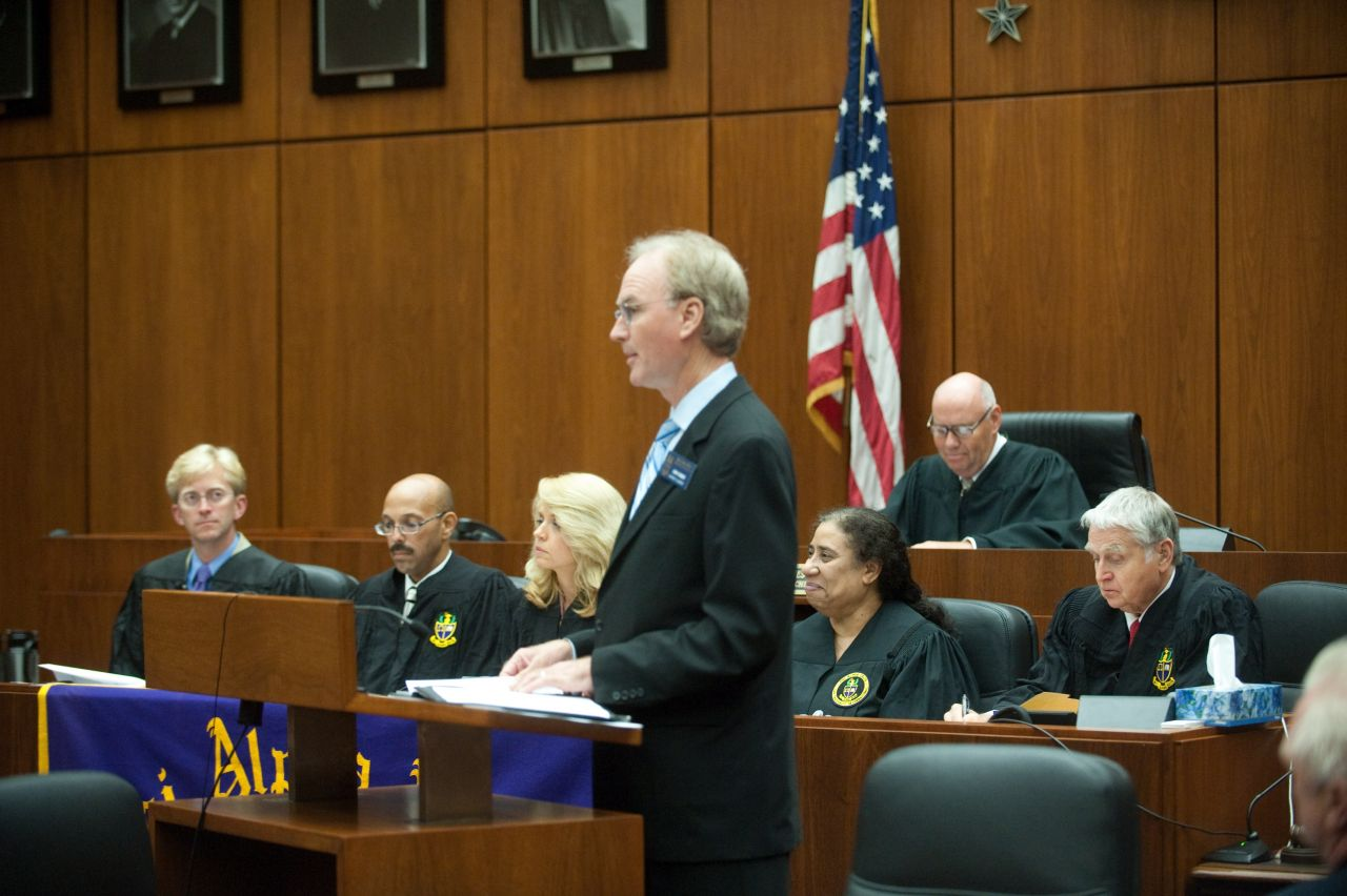 District XI Justice John K. Norris addresses the initiates during the ceremony.