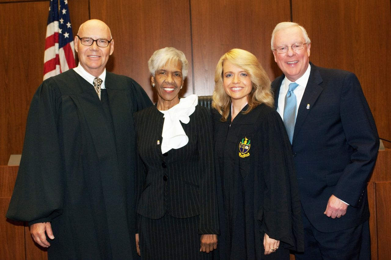 Chief Judge James F. Holderman (left) and Chapter Justice Michele M. Jochner (second from right), welcome two members of the new initiate class: Hon. Arnette R. Hubbard of the Circuit Court of Cook County, and John G. O'Brien, president of the Illinois State Bar Association.