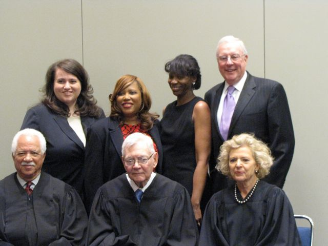 Illinois Supreme Court Justices Charles Freeman, Thomas Fitzgerald, Anne Burke and (rear) Justinian Society President Christina Mungai, WBAI President Patrice Ball-Reed, Cook County Bar Association President Marian E. Perkins and ISBA President John O'Brien