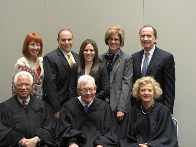 New admittee Michele Rajfer (rear, center) and family with the justices.