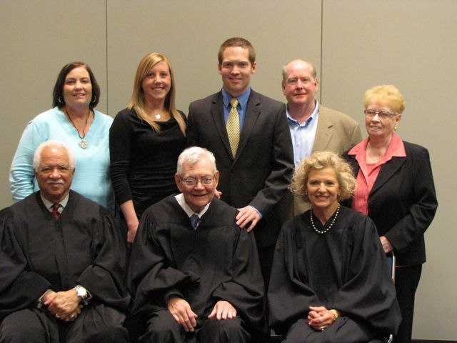 New admittee Connor Bidwill (rear, center) and his family with the justices.
