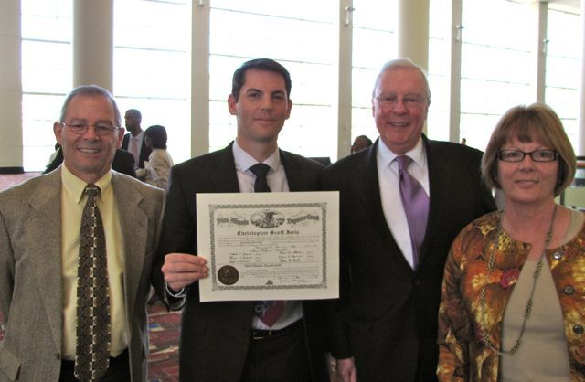 New admittee Christopher Iaria of Wheaton with his parents Joe and Marybeth with President O'Brien.