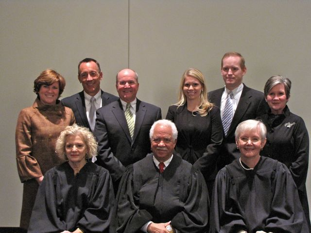 New admittee Kathryn Fox with her family and the justices.
