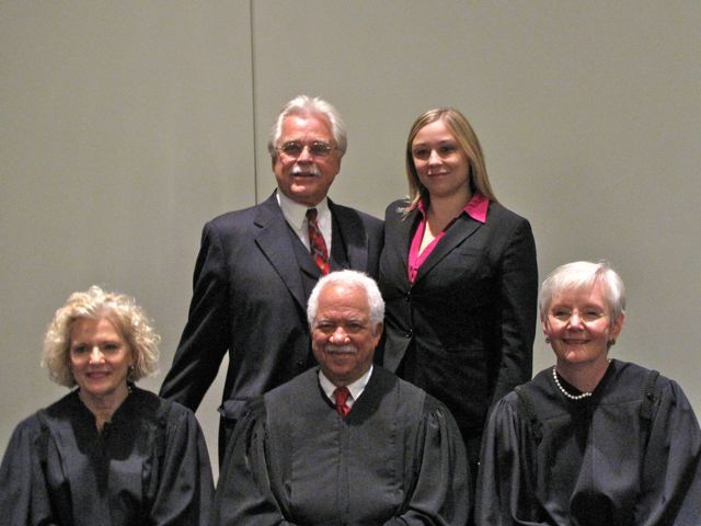 New admittee Jessica Kull with her father, Judge Geary Kull, with the justices.