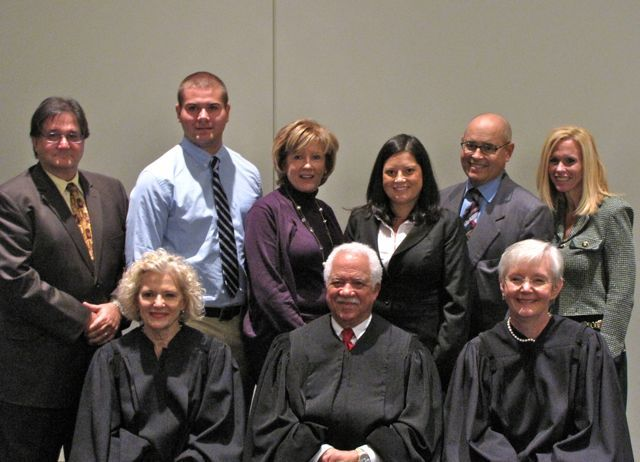 New admittee Lauren Davalle with her family and the justices.