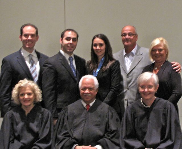 New admittee James Stathopolous with his family and the justices.