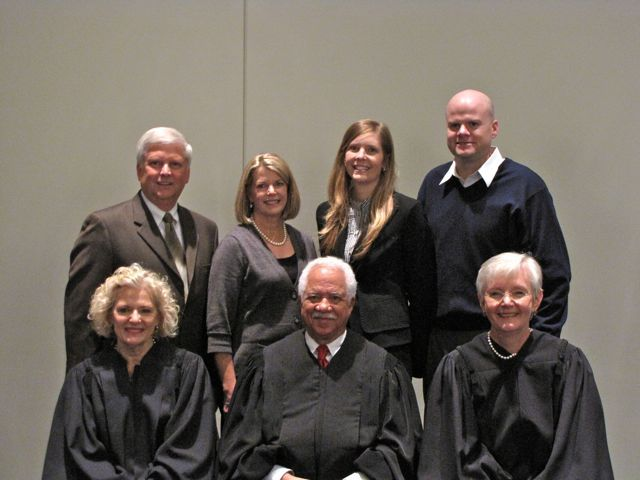 New admittee Michelle Olson with her family and the justices.