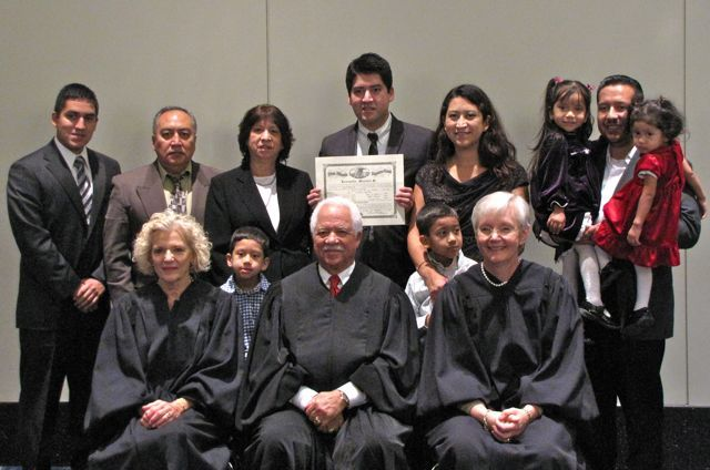 New admittee Leonardo Morales with his family and the justices.