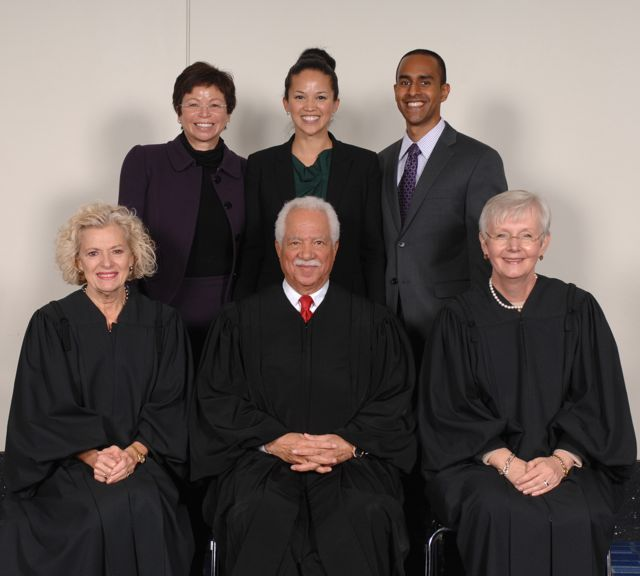 White House senior advisor Valerie Jarrett with her daughter, new admittee Laura Jarrett and friend Anthony Balkissoon pose with Justices Anne Burke, Charles Freeman and Mary Jane Theis.