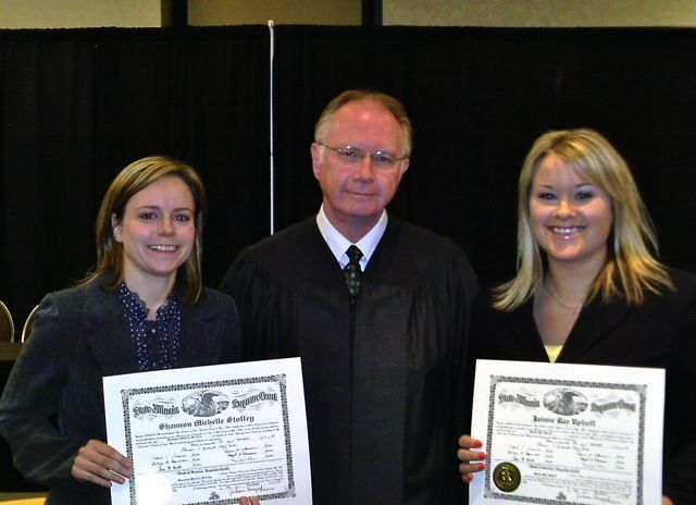 New admittee Shannon Stoffey, Chief Justice Thomas L. Kilbride and new admittee Jaimie Uphoff