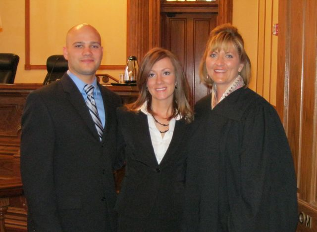 New admittee Jon Giraudo, his wife, new admittee Kelly Giraudo and Justice Mary K. O'Brien