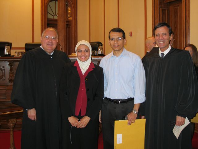 Justice Robert L. Carter, new admittee Mona Elgindy, her husband, Waleed Gabr and Justice Tom M. Lytton.
