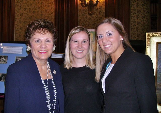 Illinois Supreme Court Justice Rita Garman with new admittees Meredith Fahrner and Cara Pratt