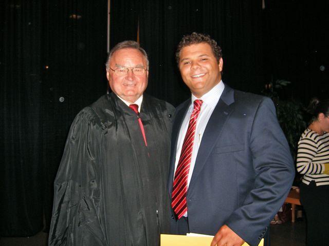 Justice Lloyd A. Karmeier with new admittee Wesley Gozia of Breese.