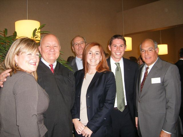 New admittee Rachael Moore Keehn (from left) with her father, Judge James R. Moore, new admittees Elizabeth Dahlmann and Mark Beatty with Mark's dad Bill Beatty (rear) and ISBA President Hassakis