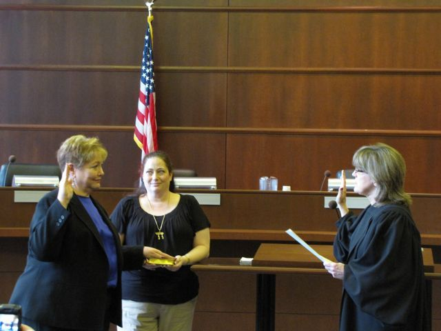 Andrea Schleifer is sworn-in by Judge Sheila O'Brien
