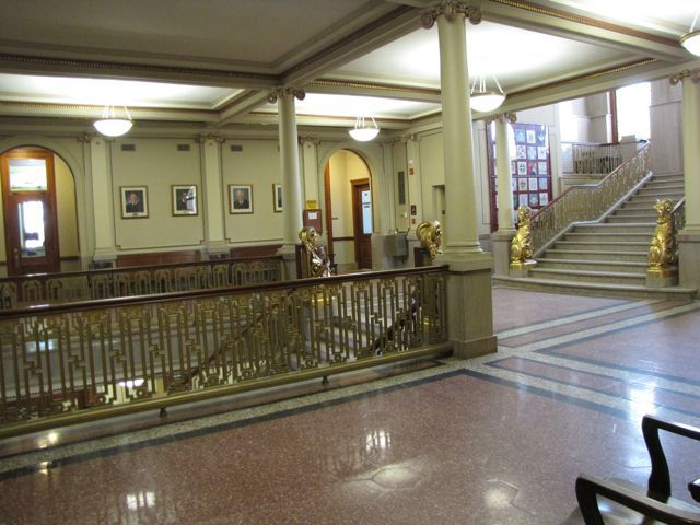 The ornate 2nd floor lobby with marble floors and four rams covered in 14K gold flanking each staircase.