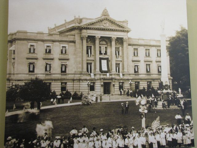 A celebration outside the courthouse following the end of World War I - notice the flags flying in each window.