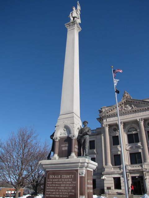 The Civil War monument towers in front of the courthouse.