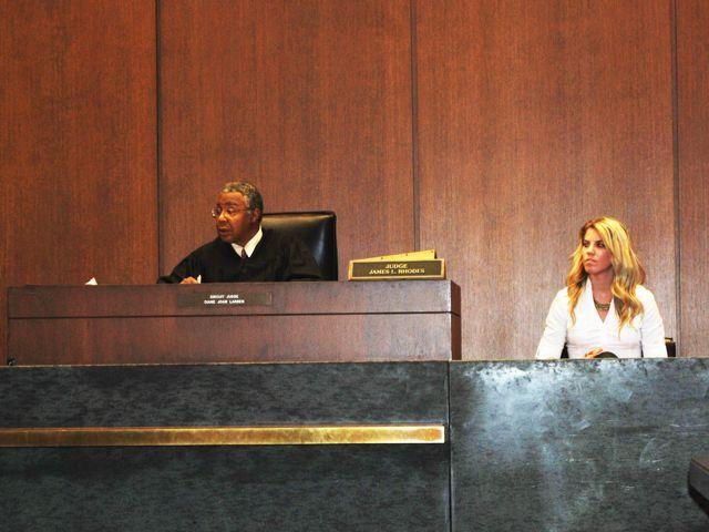 Judge James Rhodes presides over a trial.