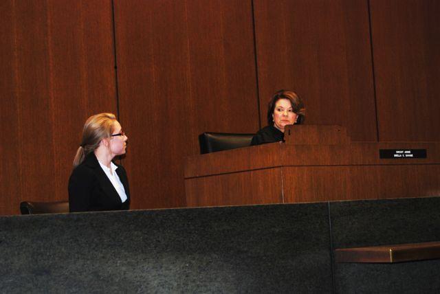 Judge Pamela Loza presides over a mock trial.