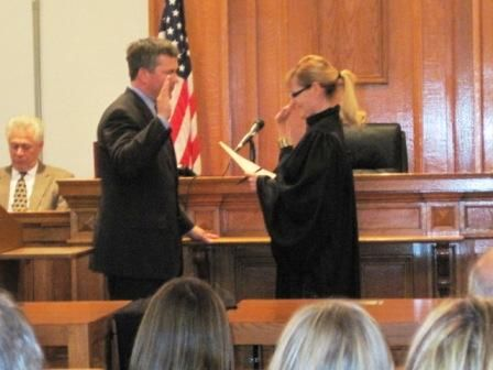 Chief Judge Ann Callis swears in William Mudge as a circuit judge at the Madison County Courthouse on Monday.