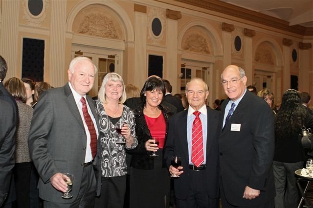 ISBA President-elect Mark Hassakis (far right) enjoys the dinner with (from left) Art Kingery of Kingery, Durree, Wakeman & Ryan, with his wife Sue, Ann Haas and Gary Rafool of Rafool, Bourne & Shelby